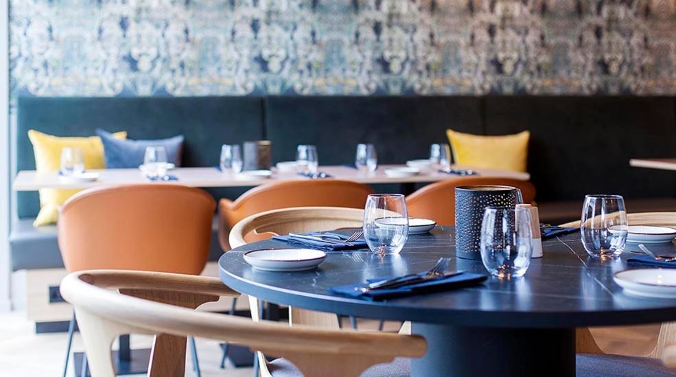En restaurant eller et spisested på Comfort Hotel Victoria Florø