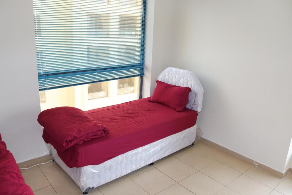 A bed or beds in a room at California Hostel Dubai Beach