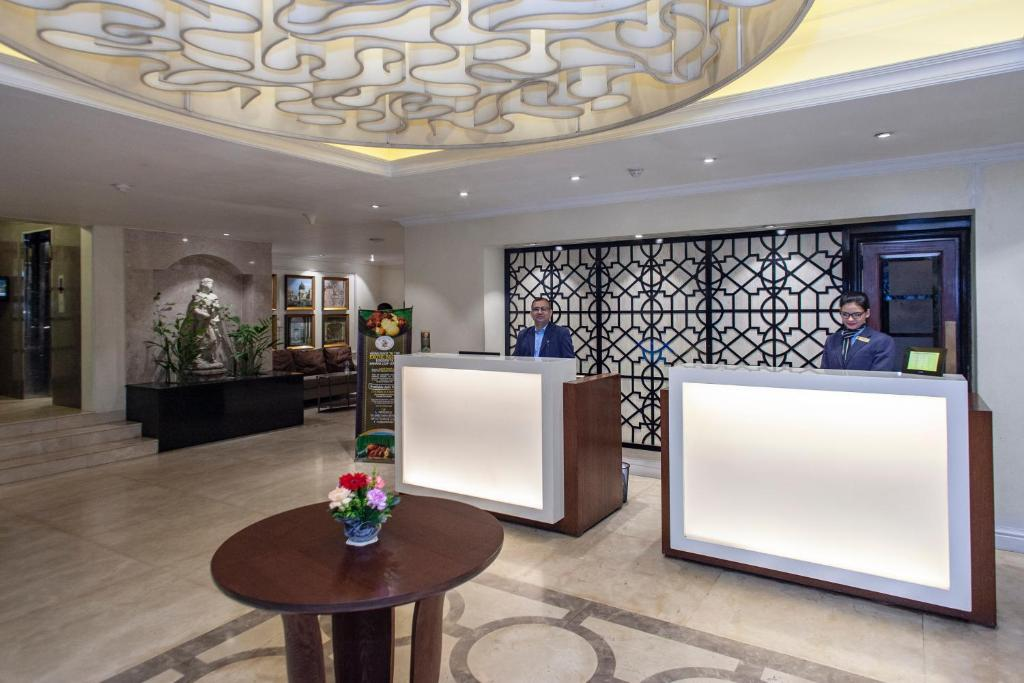 The lobby or reception area at Royal Park Residence Hotel