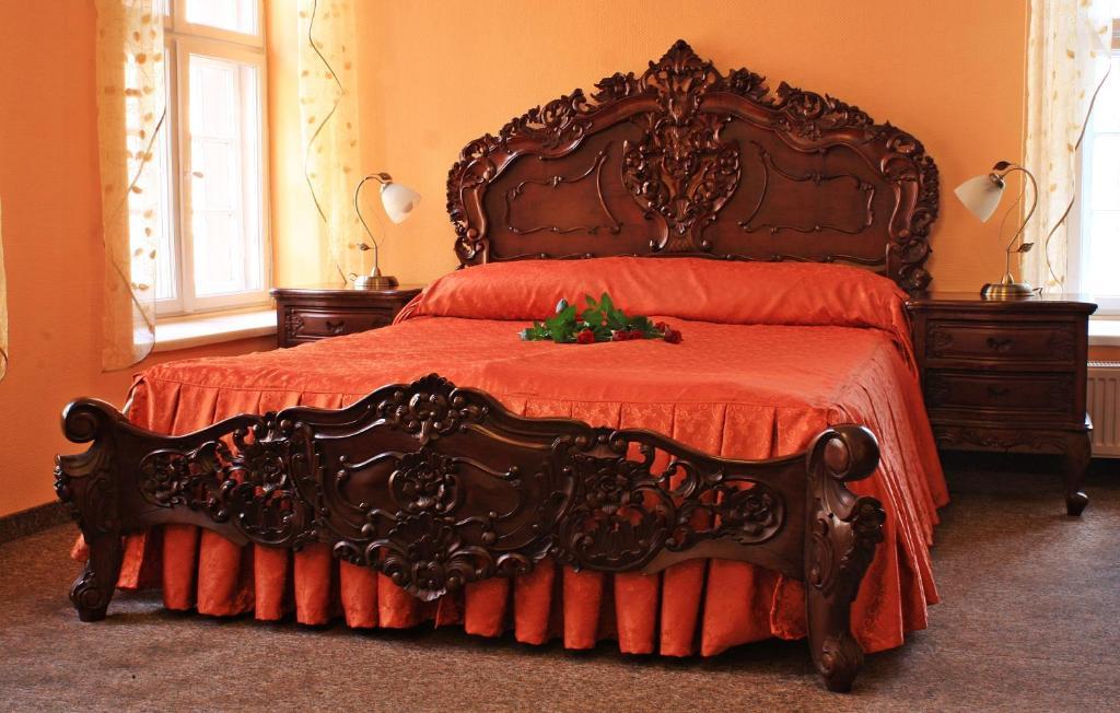 Кровать или кровати в номере Dom Schumannów