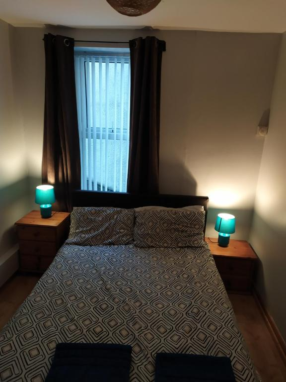 A bed or beds in a room at Monty Towers