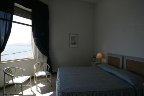 Letto o letti in una camera di Grand Hotel Fagiano Palace