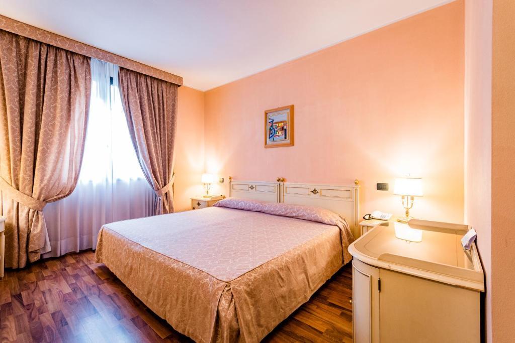 Letto o letti in una camera di Hotel Lucrezia Borgia
