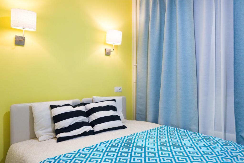 Кровать или кровати в номере Студия у Снежкома, Крокус Экспо и метро Мякинино