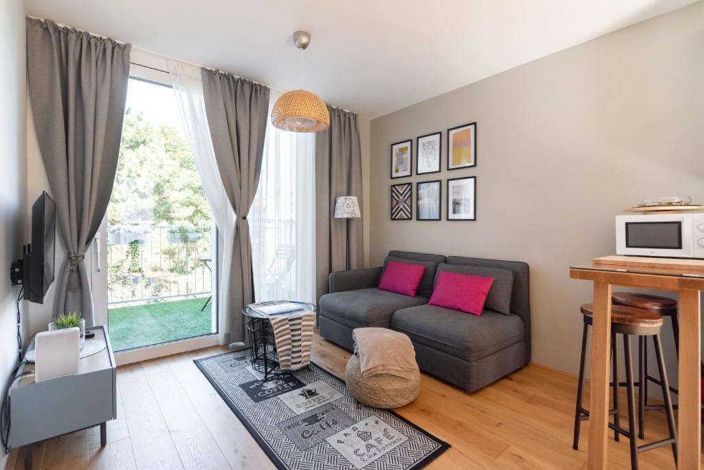 Posezení v ubytování VIC & UNO City Charming Apart Plus Garage