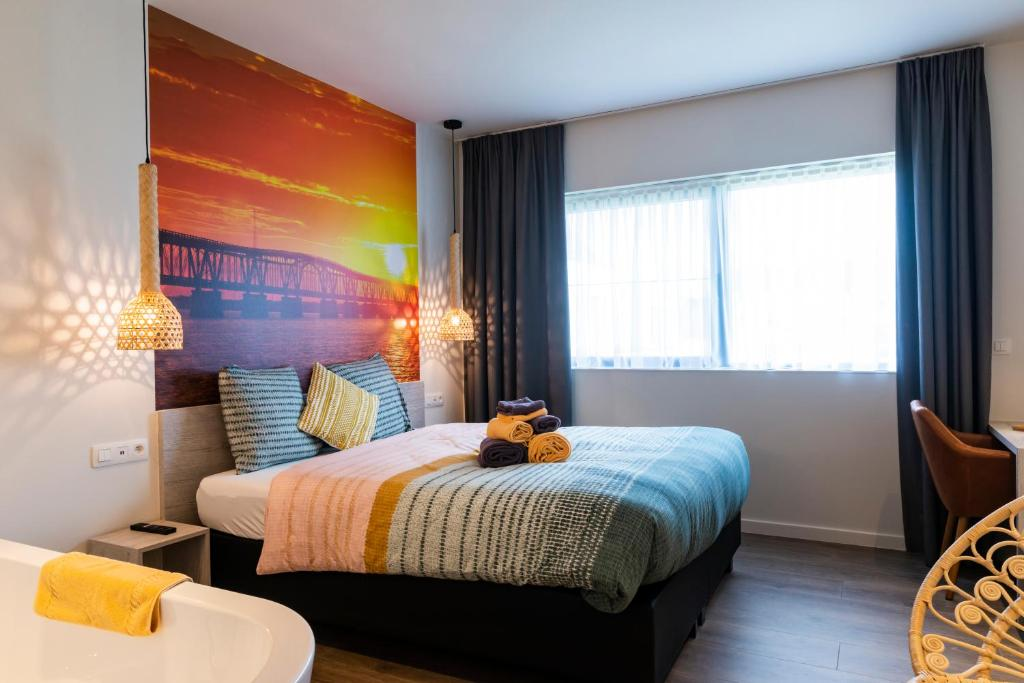 A bed or beds in a room at Eiland
