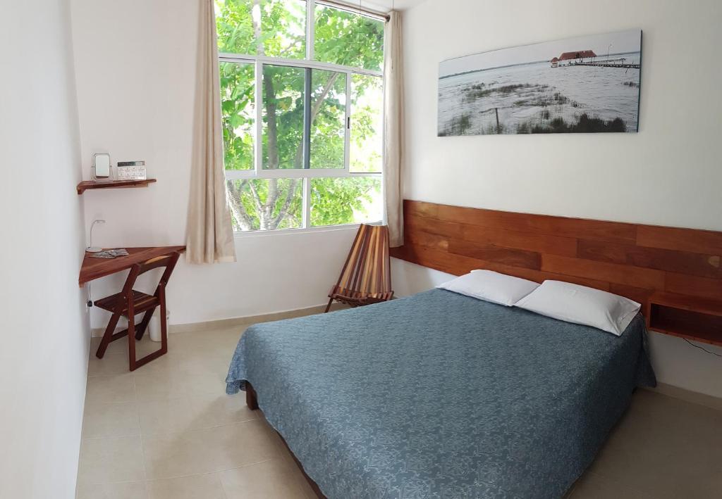 A bed or beds in a room at Gran Balam - Gran Jaguar