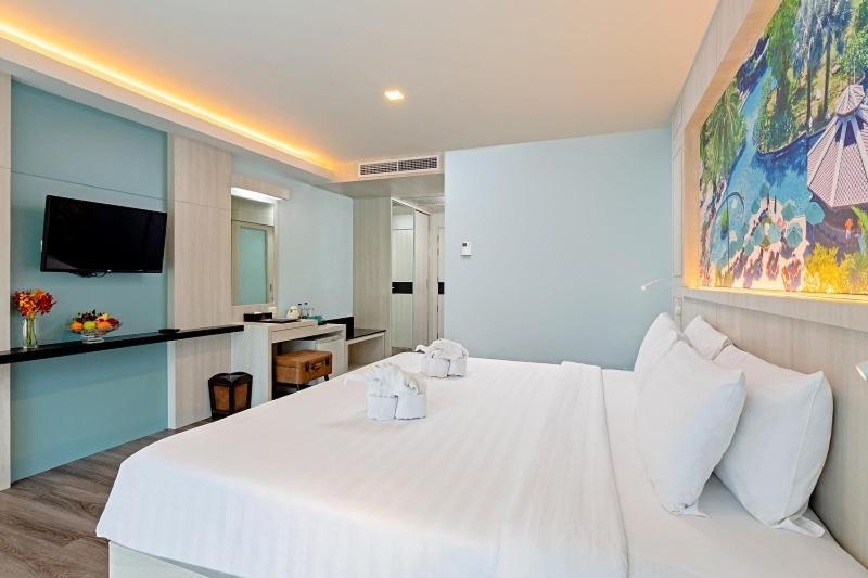 A bed or beds in a room at Duangjitt Resort and Spa