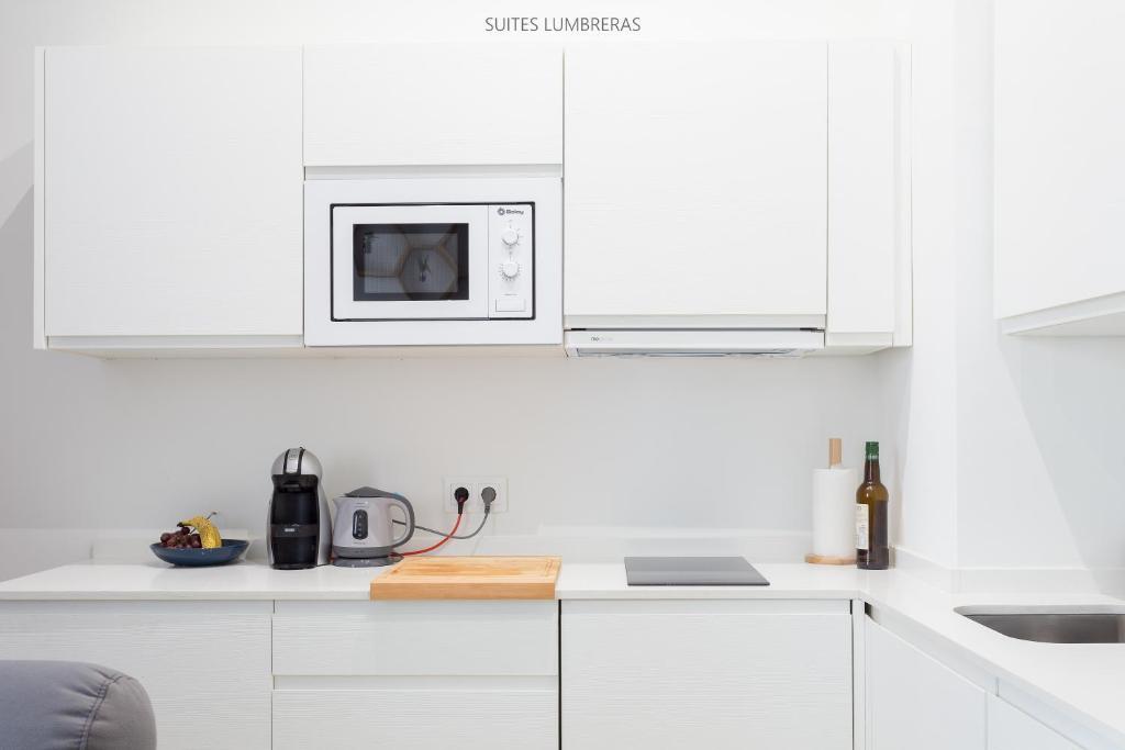 Una cocina o zona de cocina en Suites Lumbreras