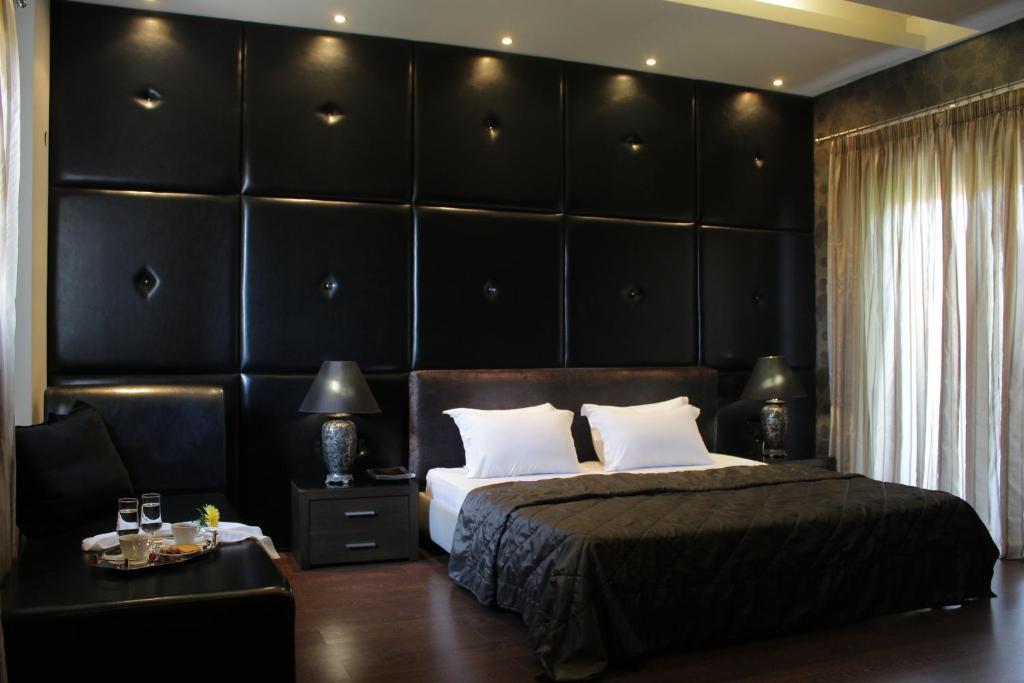 Un ou plusieurs lits dans un hébergement de l'établissement Galaxy Design Hotel