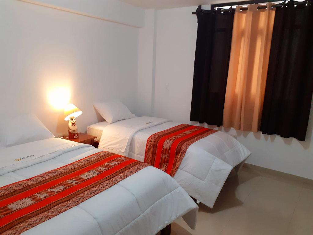 A bed or beds in a room at Chachapoyas Backpackers Hostel