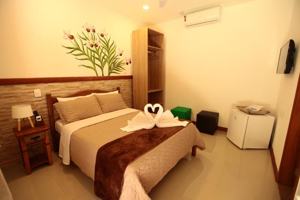 Cama ou camas em um quarto em POUSADA DAS ORQUIDEAS20