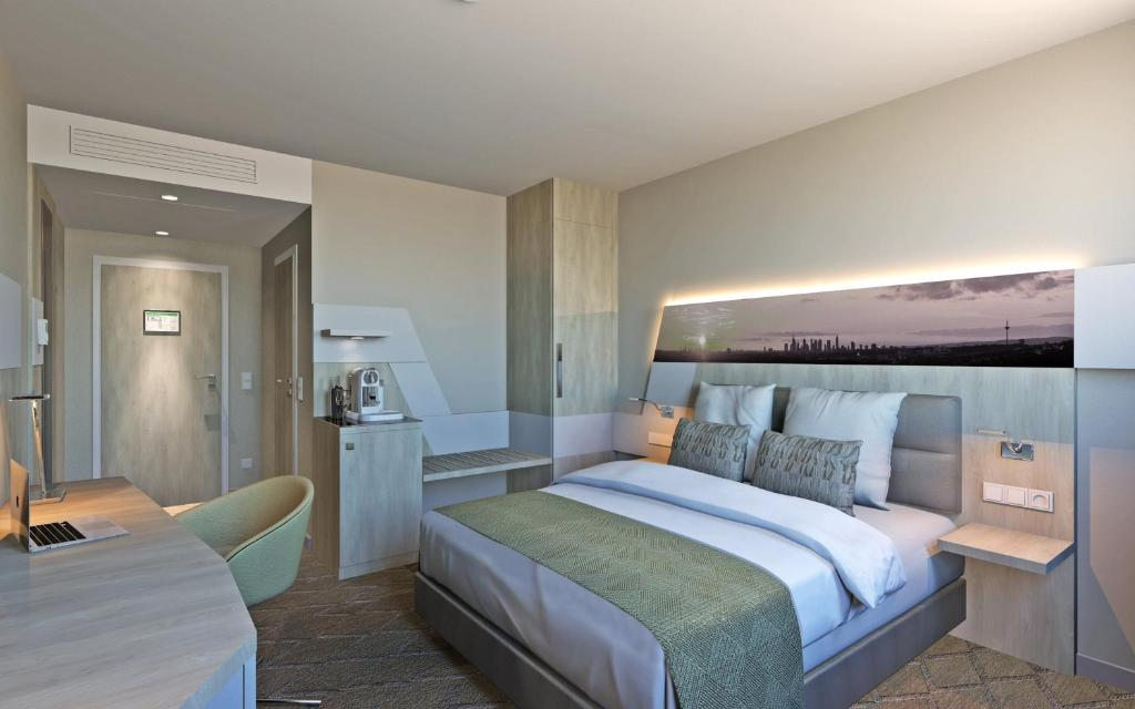 A bed or beds in a room at Holiday Inn Frankfurt Airport, an IHG Hotel