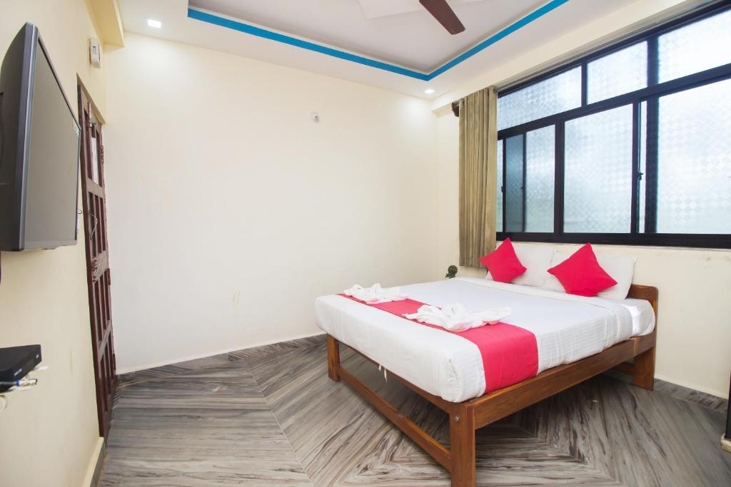 A bed or beds in a room at Trivikram Calangute