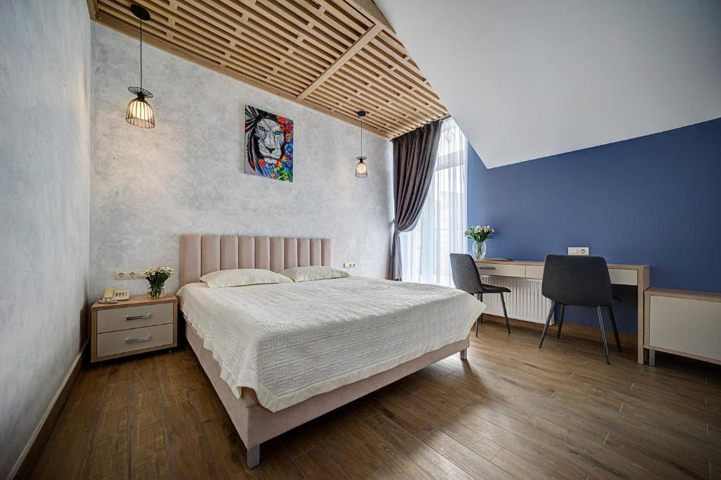 Кровать или кровати в номере Гостевой Дом Луидор