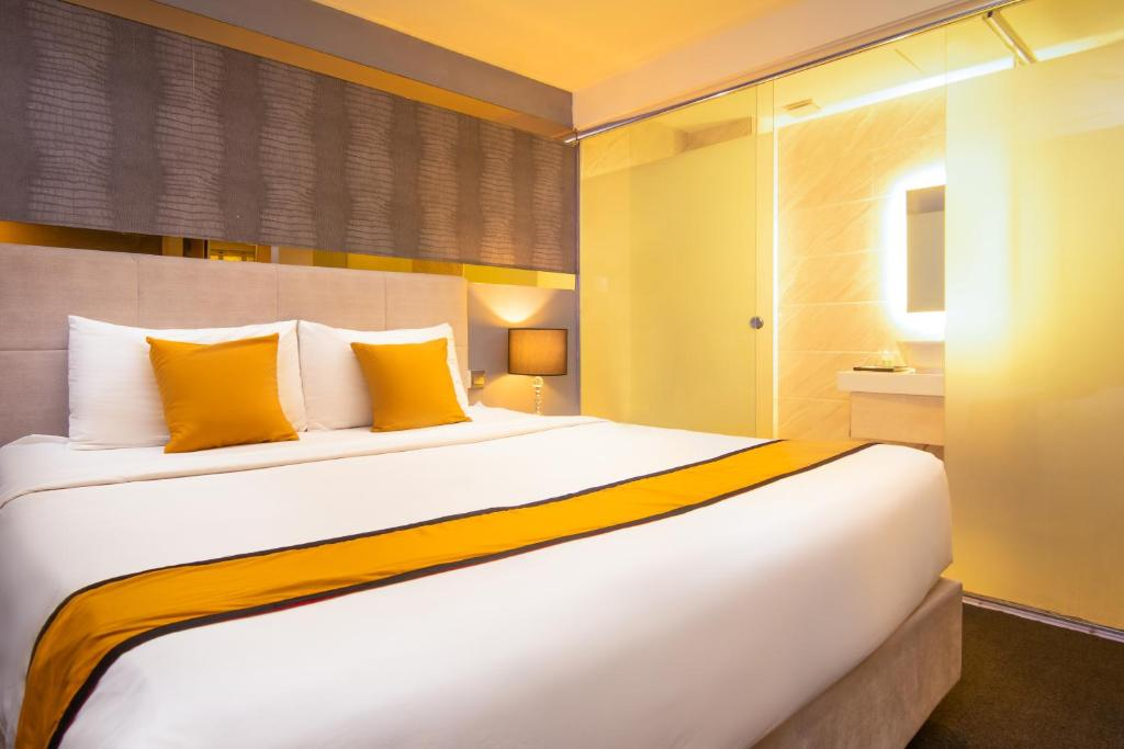 A bed or beds in a room at Royce Hotel @ KL Sentral