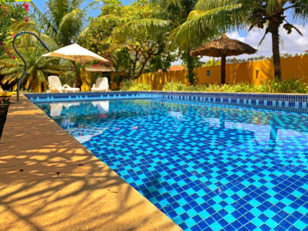 The swimming pool at or near Pousada Costeira da Barra