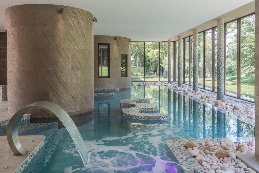 The swimming pool at or near Château De Massillan