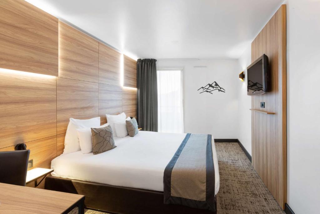 Un ou plusieurs lits dans un hébergement de l'établissement Best Western Hotel International