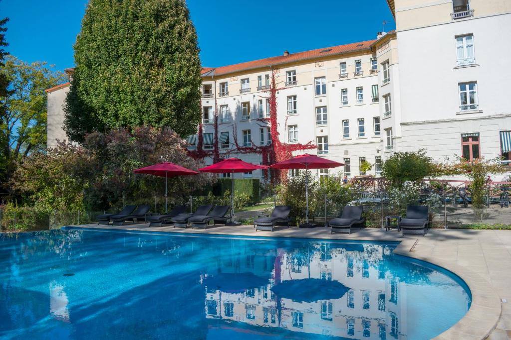 The swimming pool at or near Logis Les Loges du Parc
