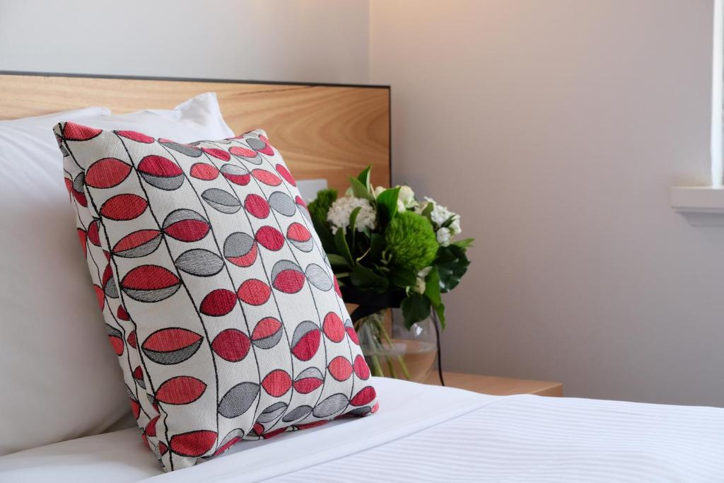 A bed or beds in a room at Apartments of South Yarra