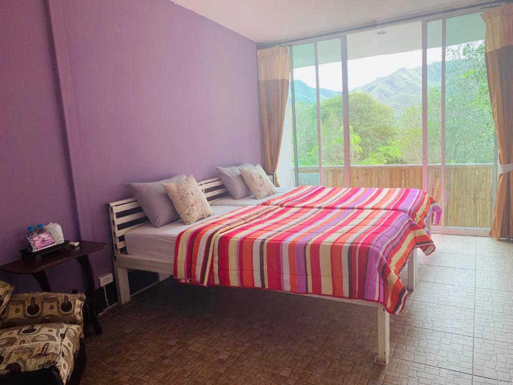A bed or beds in a room at Pai Yard Guest House