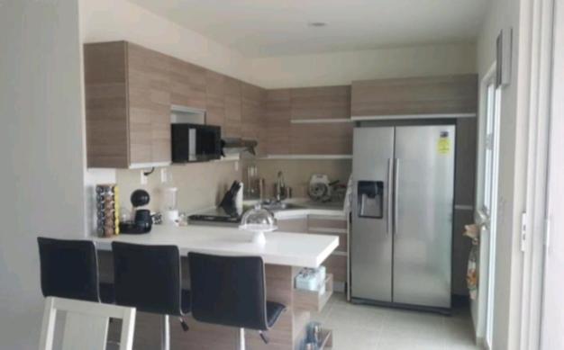A kitchen or kitchenette at Villa de pozos