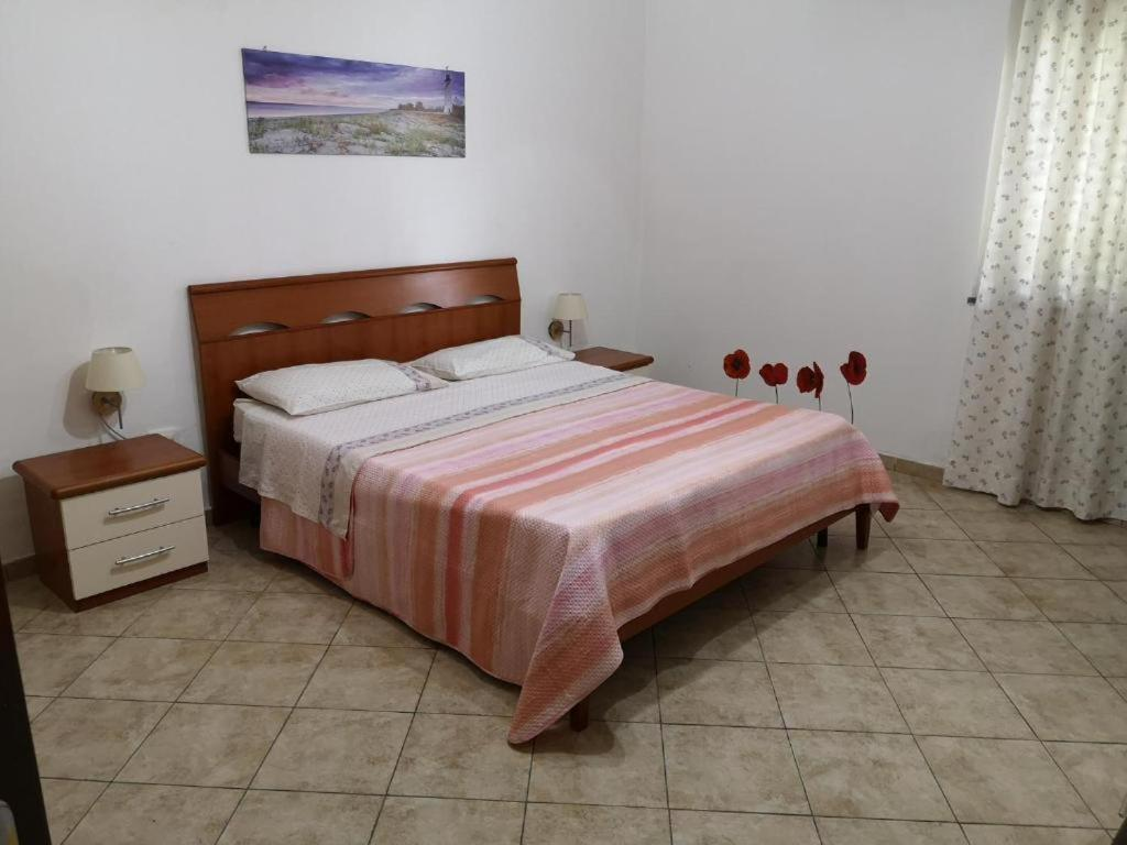 A bed or beds in a room at Appartamento a Reggio Calabria
