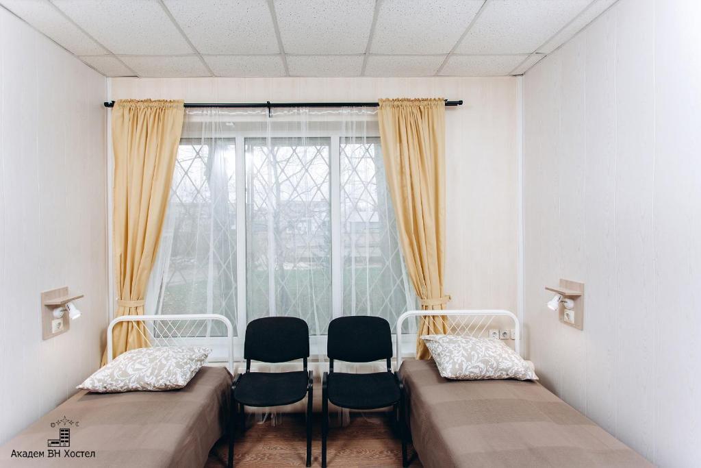 Кровать или кровати в номере Academ VN Hostel