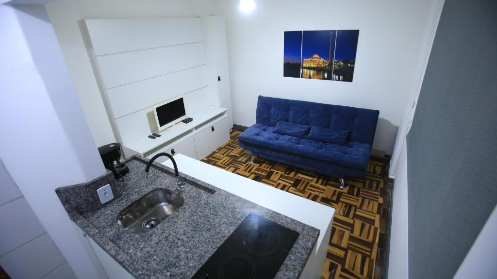 A kitchen or kitchenette at Apt central , 1 dormitório para até 6 pessoas