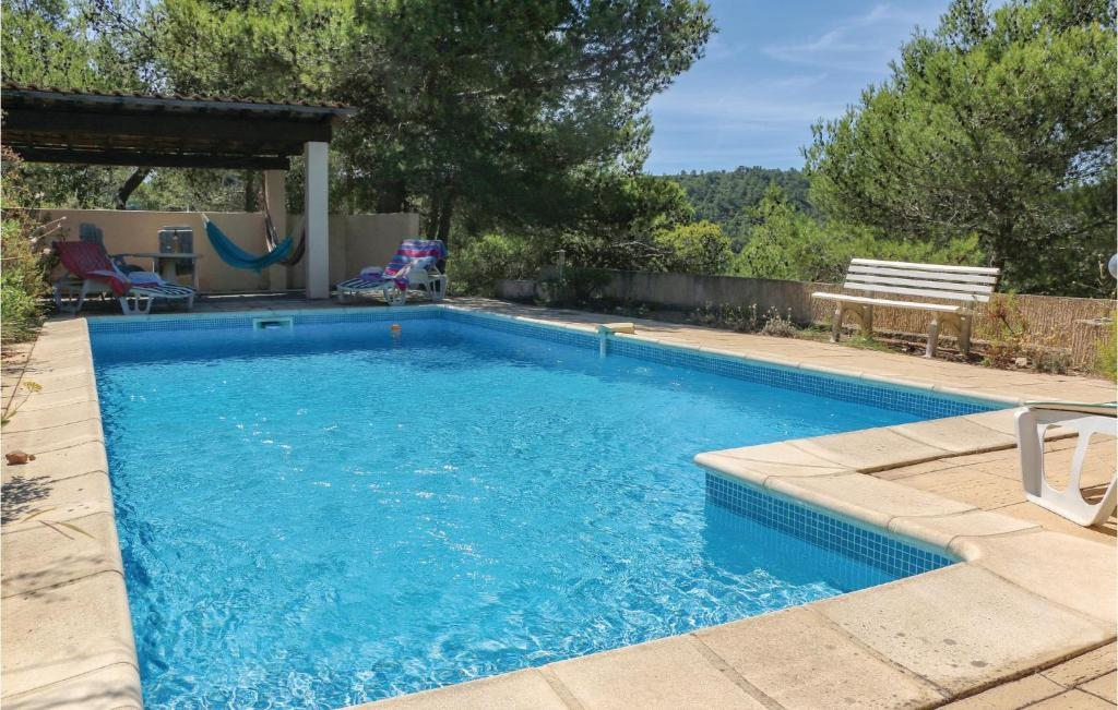 The swimming pool at or close to Awesome home in Pierrerue w/ WiFi, 3 Bedrooms and Outdoor swimming pool