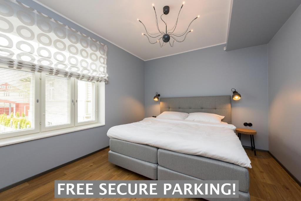 Voodi või voodid majutusasutuse Tallinn Apartment Hotel - No Contact Check In toas