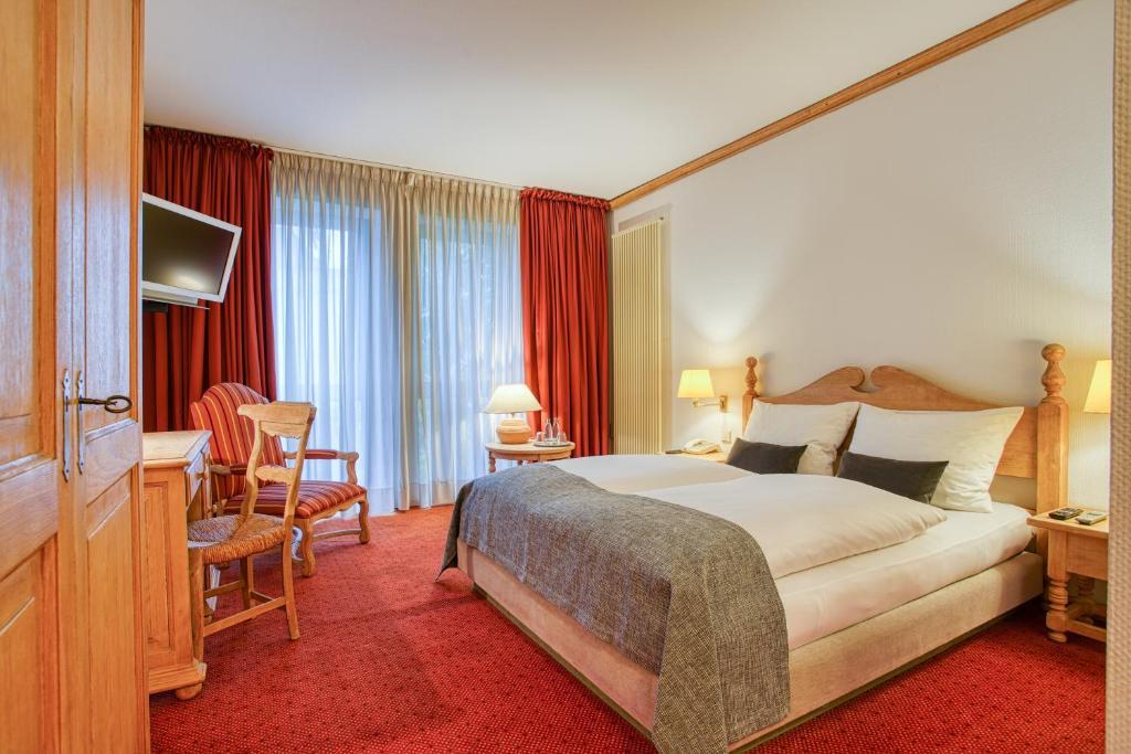 Ein Bett oder Betten in einem Zimmer der Unterkunft FF&E Hotel Stadt Gütersloh