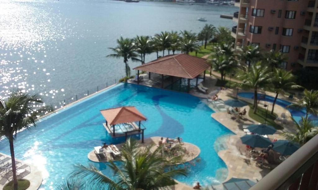 A view of the pool at Angra dos Reis - Apartamentos com Vista para o mar OU para piscina Condomínio Porto Bali or nearby