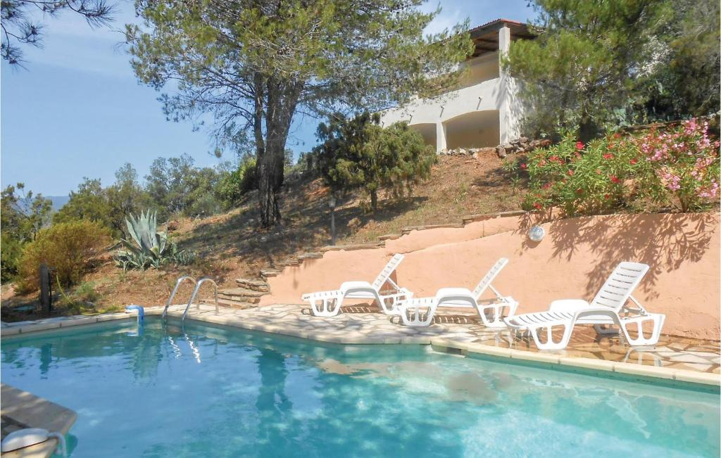 The swimming pool at or close to Awesome home in Pierrerue w/ WiFi, Outdoor swimming pool and 3 Bedrooms