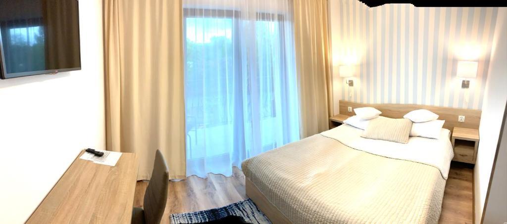 Łóżko lub łóżka w pokoju w obiekcie Wil - Art