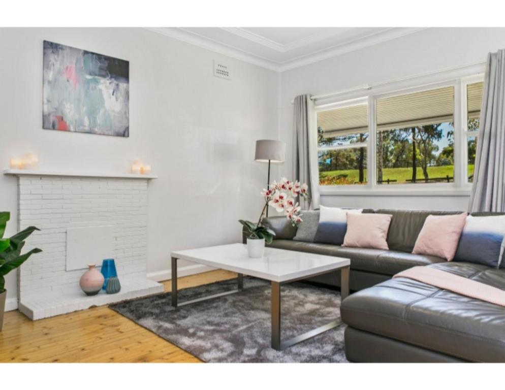 A seating area at Modern Aus home on the edge of North Ryde Oval