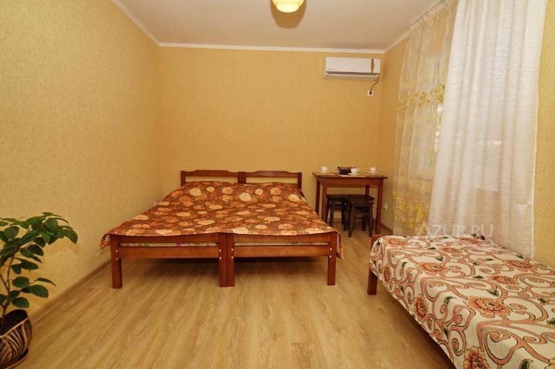 Кровать или кровати в номере Sanam Guest House