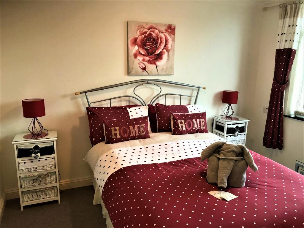 A bed or beds in a room at Haybow Farm Accommodation
