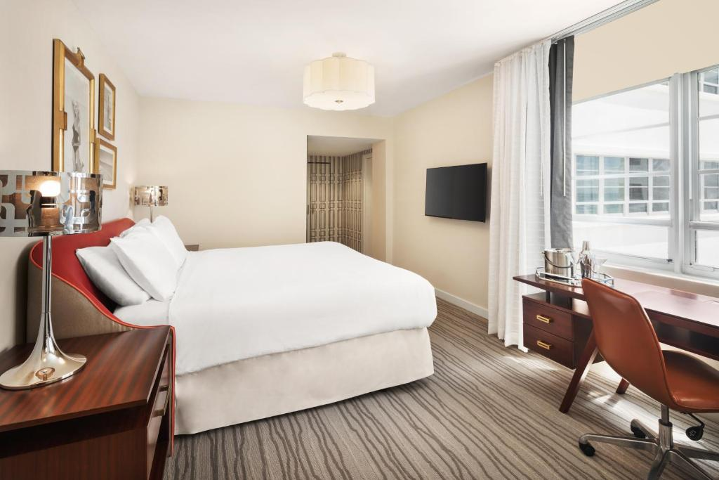A bed or beds in a room at Shelborne South Beach