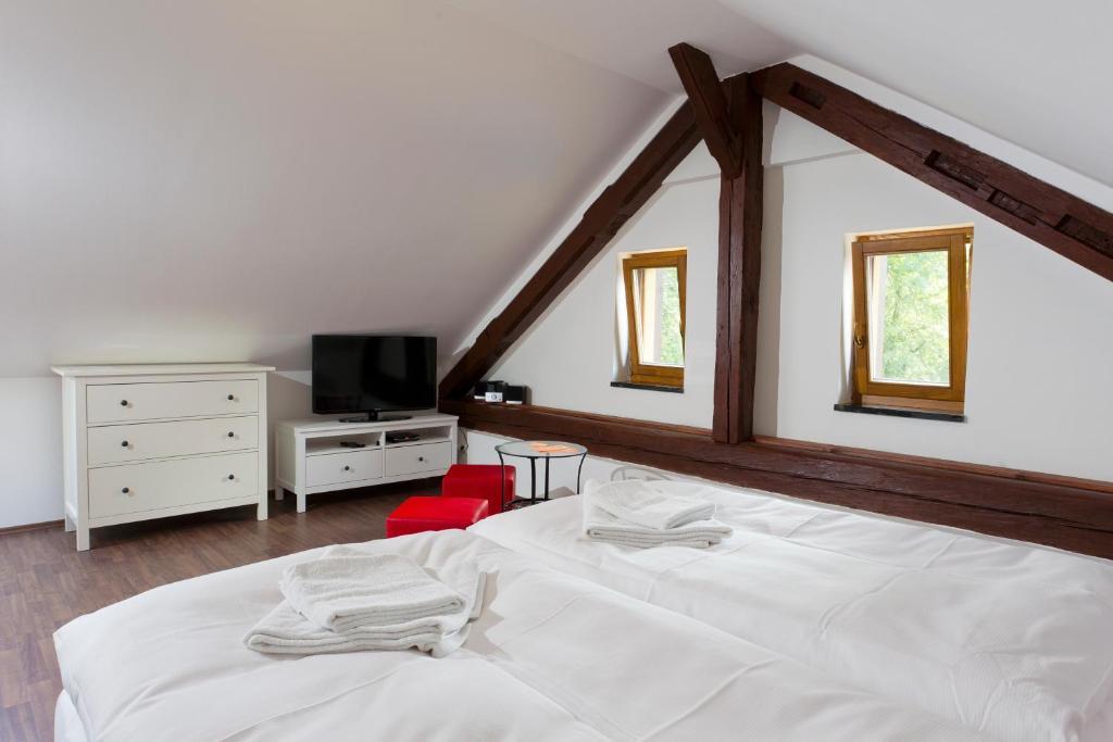 Postel nebo postele na pokoji v ubytování Havířská bouda