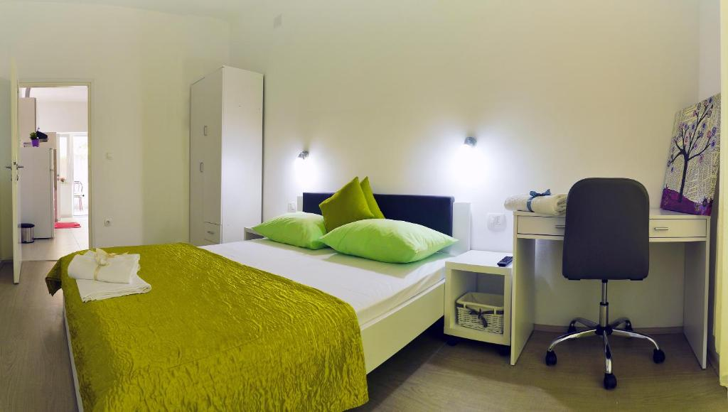 A bed or beds in a room at Firule Center Rooms