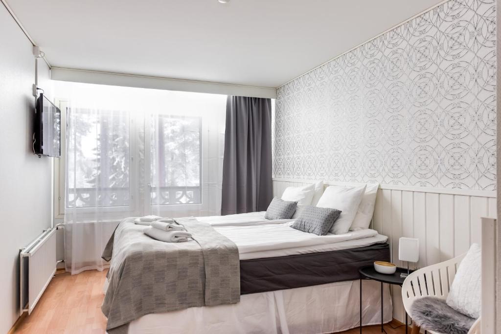 Vuode tai vuoteita majoituspaikassa Hotel Kajaani