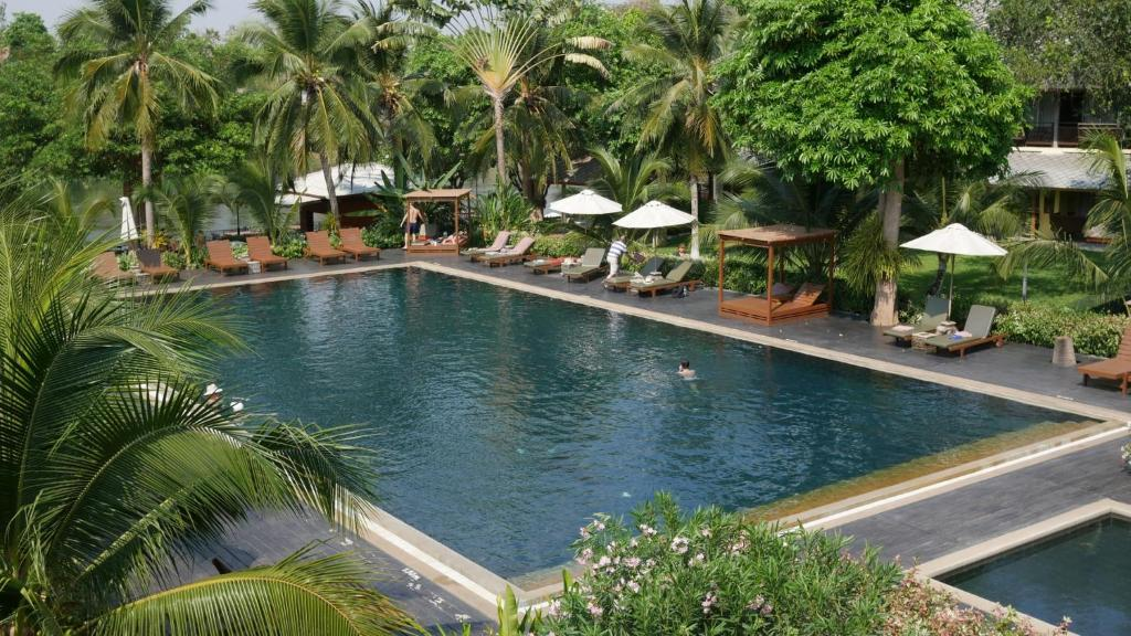 The swimming pool at or near Royal River Kwai Resort and Spa