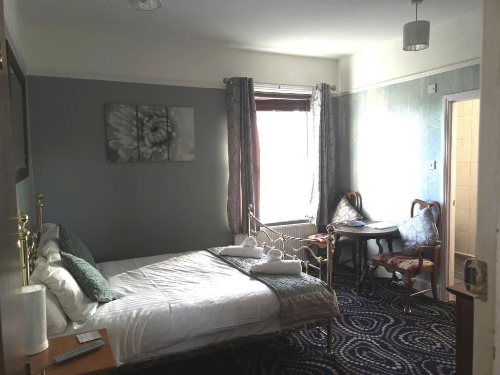 A bed or beds in a room at Waverley Inn