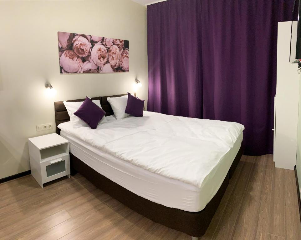 A bed or beds in a room at ABC Aparts Vnukovo