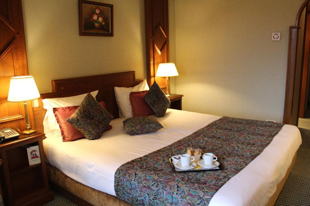 Un ou plusieurs lits dans un hébergement de l'établissement Hotel Le Mandelberg