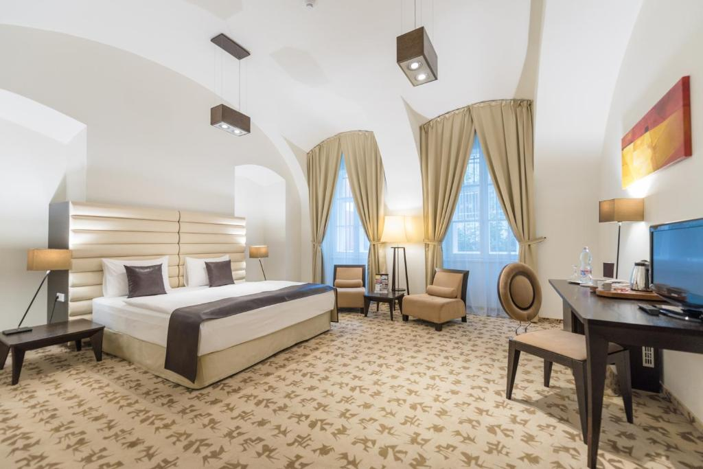 A bed or beds in a room at Buda Castle Hotel Budapest