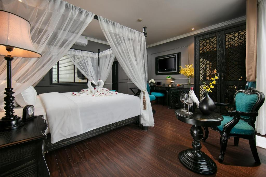 A bed or beds in a room at Grande Collection Hotel & Spa