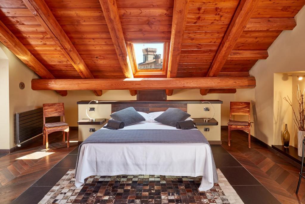 Letto o letti in una camera di Casa Svizzera Agriturismo